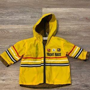 B.T. Kids yellow rain jacket 6/9 month